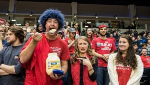 Spencer-Orrell holding a giant spoon of mayonnaise at the women's basketball game