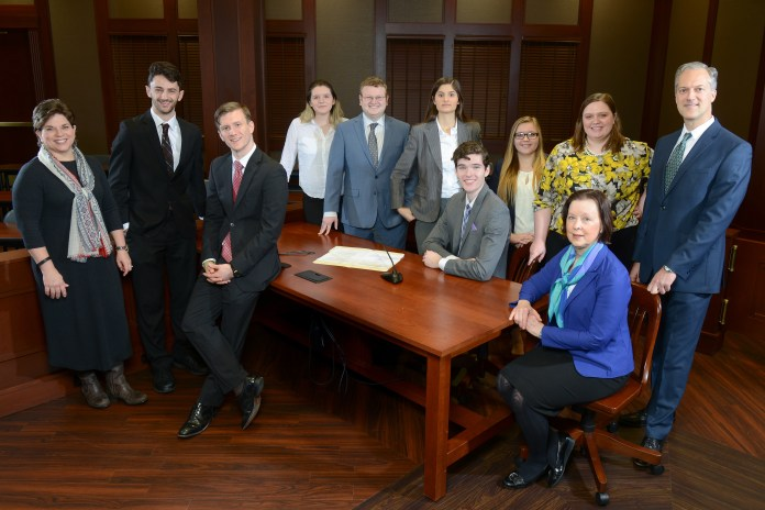Mock Trial team at Belmont with their coaches and advisors