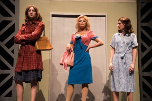 The principle actresses in 9 to 5 post on stage