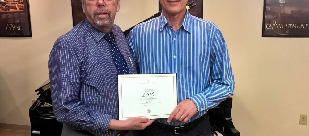 Bruce Dudley Receives the Steinway Honor, poses with another gentleman