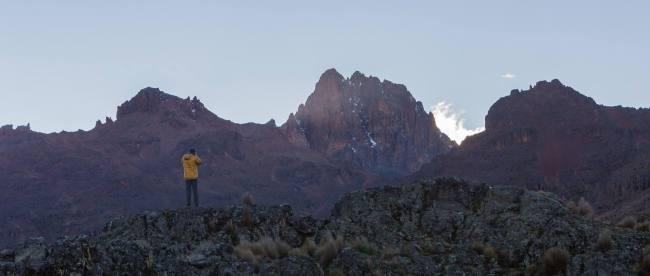 Mixon stands on an African mountaintop
