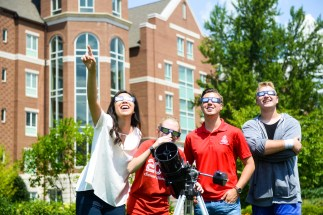 Students on the lawn, preparing for the eclipse viewing.
