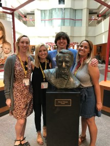 Students stand with a bust of Danny Thomas at St. Jude