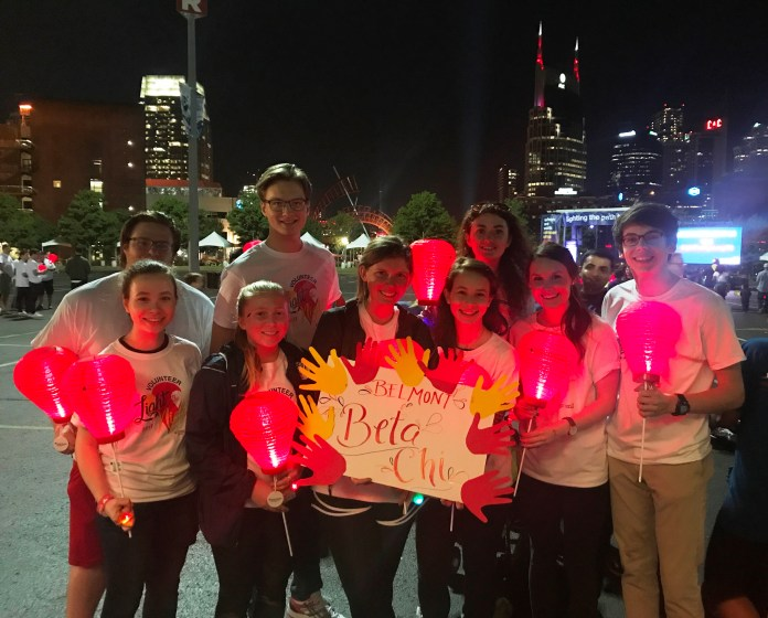 Students participate in a charity event, Light the Night 5K supporting lukemia and lymphoma.