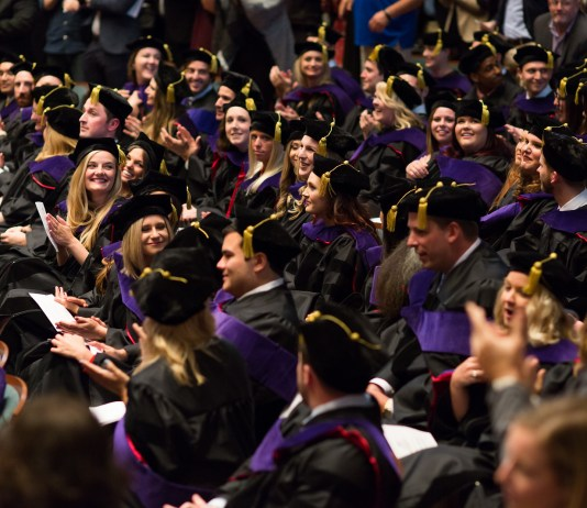 Belmont law students sit in the crowd during their hooding ceremony.