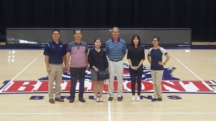 Staff members meet with the Belmont Athletics Team.