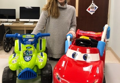 Maseline Harcrow poses with some of the ride-along cars