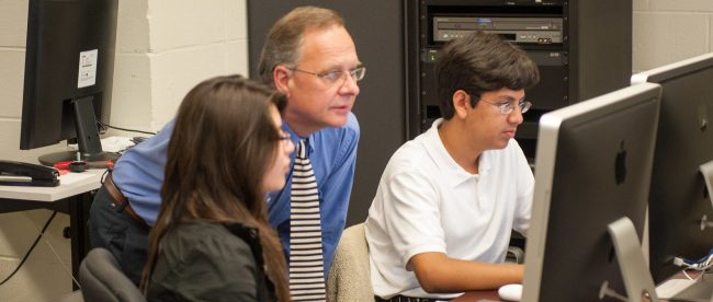 Thom Storey, Media Studies, in classroom with students