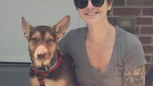 Georgia Hiatt sitting with a dog