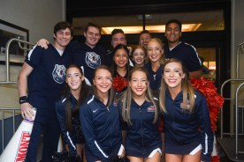 Cheerleaders pose for a picture outside the team's hotel