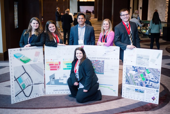 Students participants standing with their poster presentations.