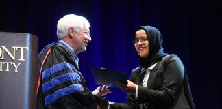 Dr. Fisher presenting award to the recipient of the fourth year presidential award