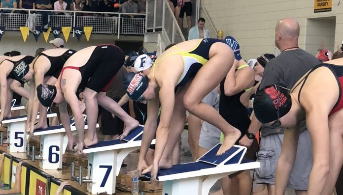 simmers on their marks, preparing to dive