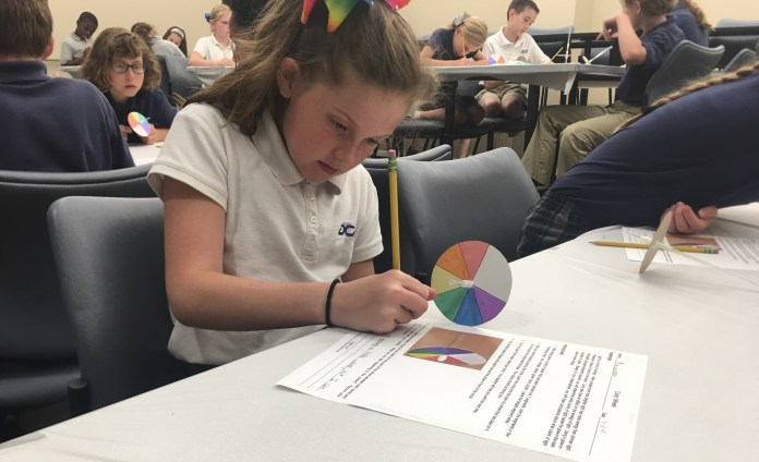A student from DCA participates in a science field trip at Belmont.