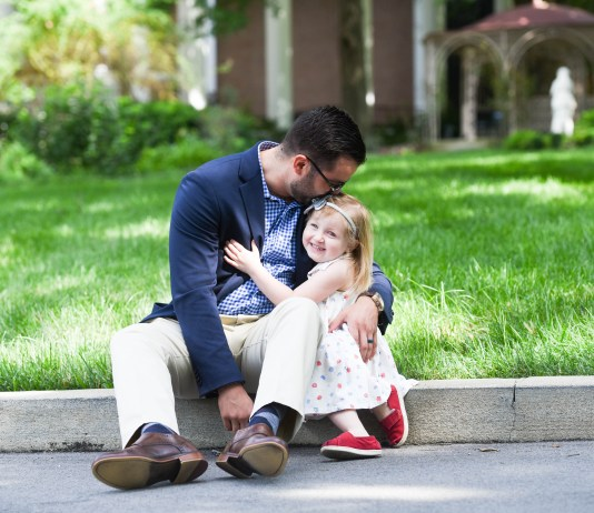 Robbie Tyrney and his daughter Zoe walk around campus at Belmont University in Nashville, Tennessee, June 5, 2018.