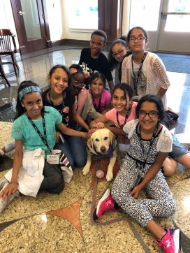 Students pose for a photo with Layla, the therapy dog!