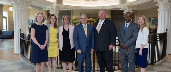 Mayor David Briley and other speakers from the Business Assistance Symposium pose in the Janet Ayers Academic Center lobby