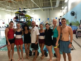 PT and OT students stand in front of the swimming pool at a recent volunteering opportunity with the Nashville Dolphins