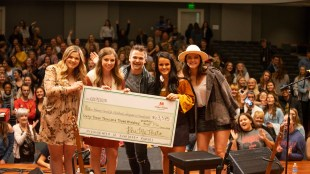 Phi Mu BonnaMu fundraiser with Hunter Hayes presents check for donation