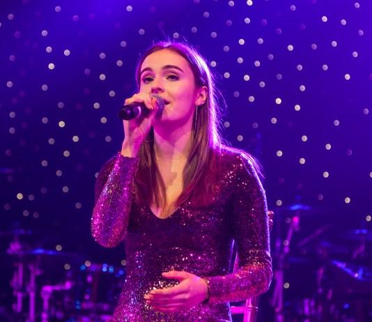 Mackenna Swann sings onstage