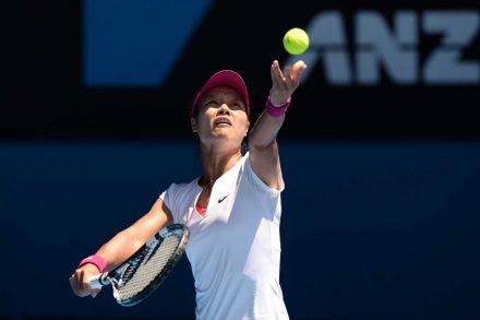 Eyes on the prize ... Li Na serves against Eugenie Bouchard
