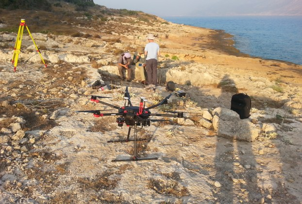 Purdue team setting up the drone at Dana Island