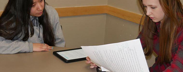 Miriam Rojo-Gutierrez watches as Katie Murphy reviews her writing