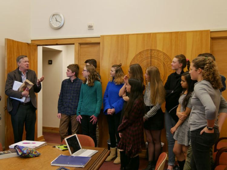 Ninth graders meet with Gov. John Hickenlooper to discuss immigration issues.