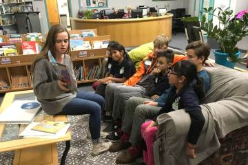 Rebecca Kerr, James Doolittle, and Grady Behrhorst used children's books to help talk about personal stories of immigration with a group of third graders at Castro Elementary School in Denver.