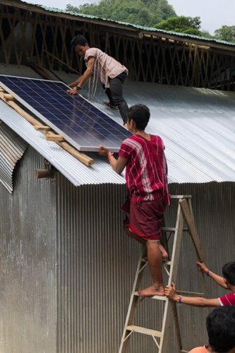 Installing the solar panels on a school for Karen refugees