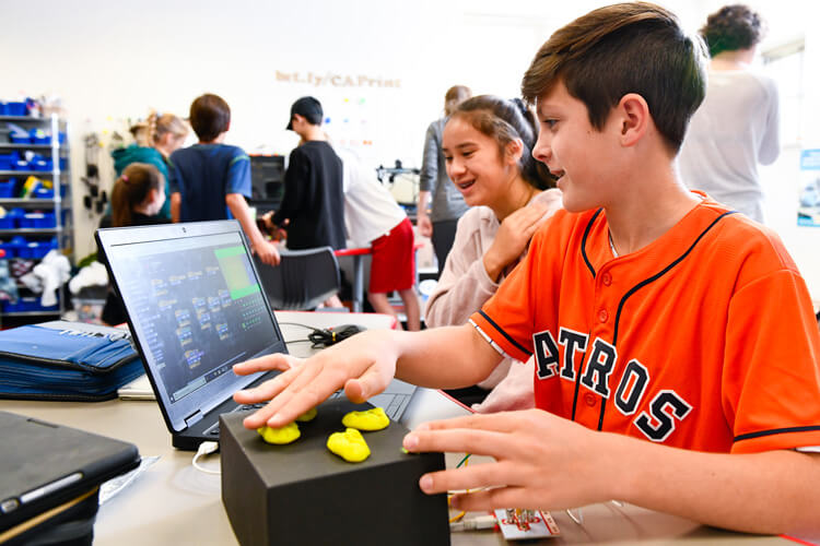 Middle School students learn coding