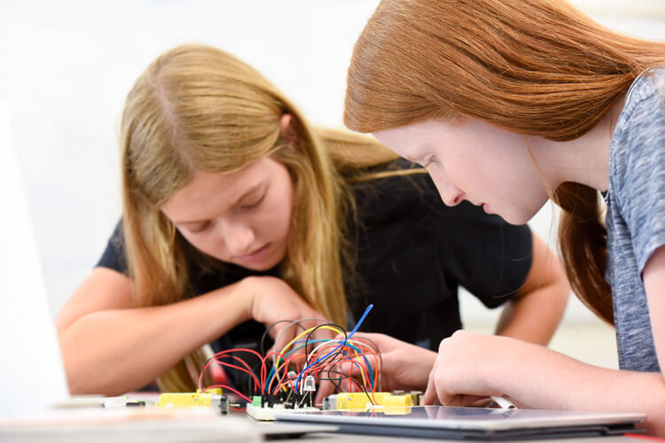 Upper School students work with circuit boards