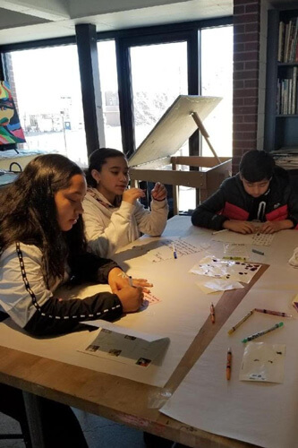 Horizons students write holiday cards to patients at Children's Hospital Colorado.
