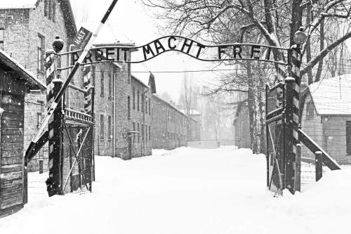 Sing Arbeit macht frei (Work liberates) in Auschwitz II Birkenau concentration camp located in the west of Krakow, Poland
