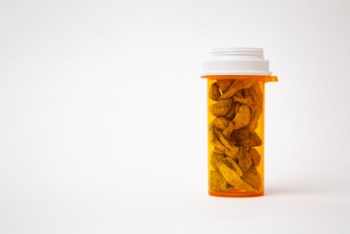 "<img src=""prescription bottle"" alt=""psilocybin inside orange prescription bottle"">"