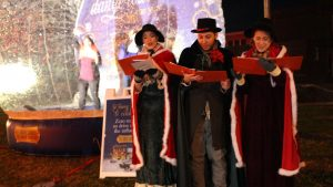 Carolers and blow up snow globe