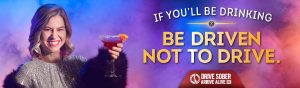 Girl holding up drink promoting not driving while driving