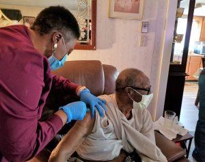 Man gets COVID-19 vaccine.