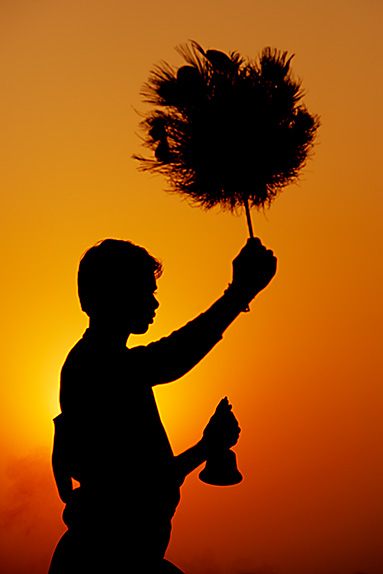 Young Boy Performing Daily Ritual to Celebrate Sunrise