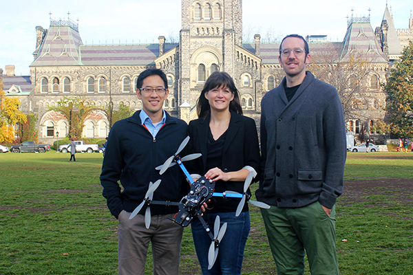 From left: Professors Tim Chan (MIE), Angela Schoellig (UTIAS) and PhD candidate Justin Boutillier (IndE) found that drone delivery of automatic external defibrillators could shave crucial minutes off ambulance response times in both rural and urban regions. (Credit: Liz Do).
