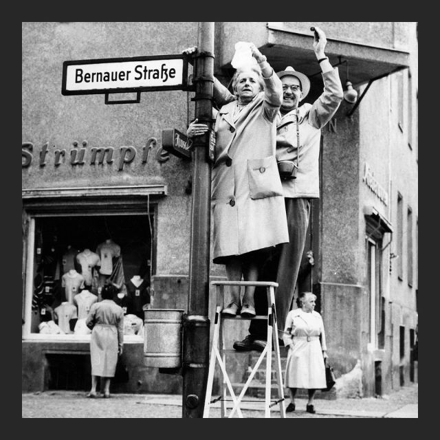 West Berlin citizens waving to East Berlin on Bernauer Strasse, 1961.