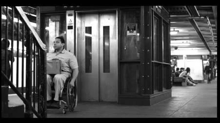 man in wheel chair outside a broken MTA elevator