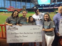 Koslowski (right) with a check for the Special Olympics Florida from the Marlins Foundation.