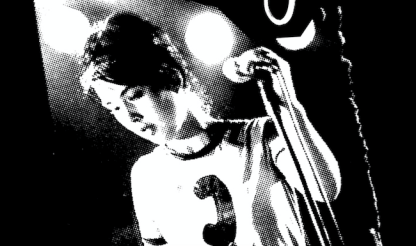 Kathleen Hanna at a microphone during a concert
