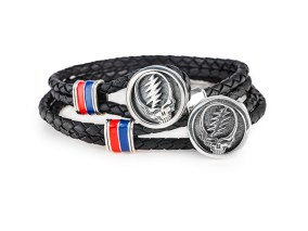 "The ""Steal Your Face"" bracelet, made of sterling silver, enamel, and a woven leather cord, is part of the Grateful Dead Collection."