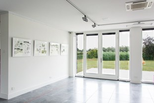 Gallery view with doors to outside space