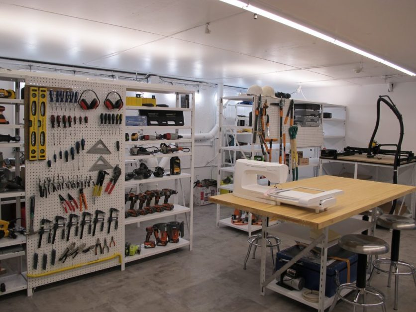 room with sewing machine, levels, power drills, and other tools