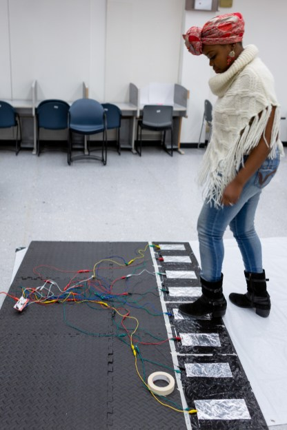 A student works on a giant electronic keyboard.