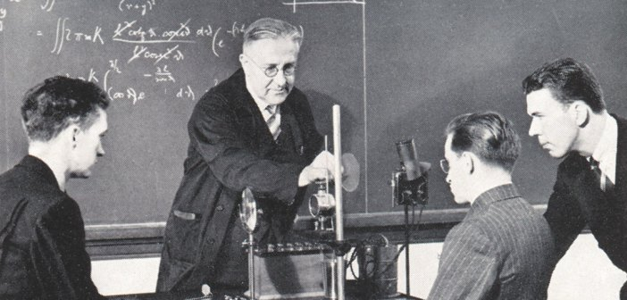 Fordham professor and Nobel Prize-winning physicist Victor Hess in the lab with students, 1940s