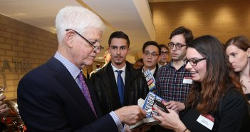 Mario Gabelli signing books for Gabelli School Students at the McNally Amphitheatre